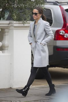 Pippa Middleton looked immaculate in a grey coat by Fay and her favourite flat black boots...