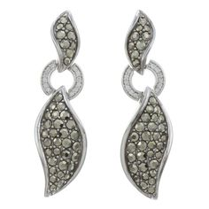 Round-cut SWAROVSKI marcasite gemstones in a variety of sizes adorn the wavy shapes of these earrings from CHROMA, along with clear cubic zirconia. Crafted of sterling silver, these earrings attach wi