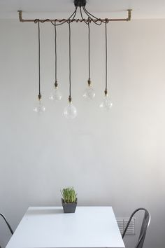 Simple lighting detail. Urban Cottage Industries. Pendant Lights. Filament Bulbs.