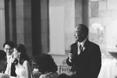 Toasts during a Tappan Hill Mansion wedding reception. Captured by NYC wedding photographer Ben Lau.
