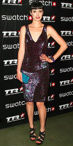 KRYSTEN RITTER  from Breaking Bad The actress's sequin Monique Lhuillier frock pairs well with her attention-grabbing accents, including an aqua enamel box clutch, a sporty purple watch, thick-strapped sandals and her signature glossy lips, at the Swatch Art Rules Event in Culver City, Calif.