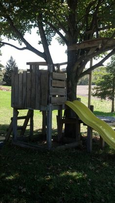 the start of our summer tree house made from old swing set, tree, & pallets! i only spent @ $25 on hardware!