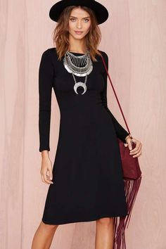 You need this structured black dress in your life.