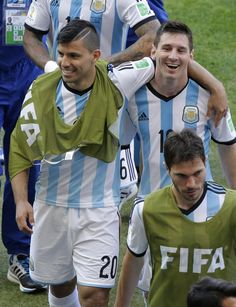 Argentina's Lionel Messi jokes, right, with Argentina's Sergio Aguero as he leaves the pitch after the group F World Cup soccer match between Argentina and Iran at the Mineirao Stadium in Belo Horizonte, Brazil, Saturday, June 21, 2014. Lionel Messi scored a superb goal in stoppage time to give Argentina a 1-0 victory over Iran