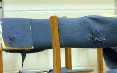 Chairs with bullet holes in the seat backs taken from Columbine High School are shown on display at the Jefferson County Fairgrounds February 26, 2004 in Golden, Colorado.