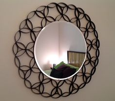 """My take on the whole toilet paper roll crafts. Perfect to frame out a mirror over my dresser. Flatten the rolls, cut in 1/2 inch strips, arrange around the mirror, glue the TP pieces together, and spray paint.  The mirror is hung with a large plate hanger and the """"frame"""" fits perfectly. A few small, strategic stick pins keep anything from drooping. A fun and funky mirror!"""