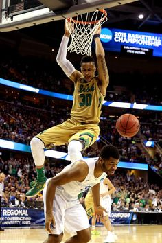 34205809cc3e Zach Auguste  30 of the Notre Dame Fighting Irish dunks against Andrew  Harrison  5