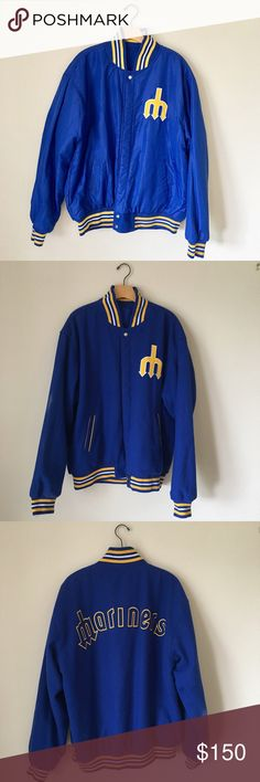 Retro vintage reversible Seattle Mariners jacket Retro/vintage inspired reversible Seattle Mariners bomber letterman jacket. One side 55% wool and features an embroidered yellow leather M on the front, pockets, and embroidered yellow Mariners on back. Other side is more of a windbreaker, bomber jacket material and features the embroidered leather yellow M. Snap closures. Some fading/staining on inner right wool-side sleeve (see photo). Otherwise excellent condition. JH Design Group Jackets…
