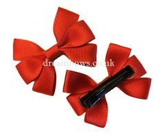 Plain red grosgrain ribbon hair bows on alligator clips. School hair accessories from www.dreambows.co.uk #redhairbows #ribbonhairbows #alligatorclips #schoolhairbows #schooluniform #girlsbows #girlybows #stylishbows