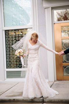 Love this bride dazzle in stunning dress + bridal veil