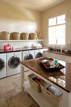 Design tip: If you have a large laundry room, consider adding a spacious folding table with a shelf below. You can stow baskets of sorted clothes below, and the top can double as a craft or sewing space when you are not folding clothes