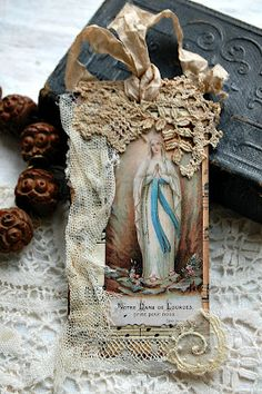 This tag would make a lovely gift at Christmas.  Use an antique holy card, vintage lace and dyed ribbon or seam binding for hanging.  Beautiful!
