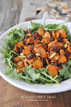 Roasted Carrot Salad topped with slivered almonds and dried cranberries!