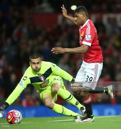 Marcus Rashford of Manchester United in action with Adam Federici of AFC Bournemouth during the Barclays Premier League match between Manchester United and AFC Bournemouth at Old Trafford on May 17, 2016 in Manchester, England.
