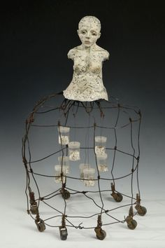 Elissa Farrow-Savos: Stories She Told: polymer, oil paint, vintage: wire basket, wheels, film canisters, book pages