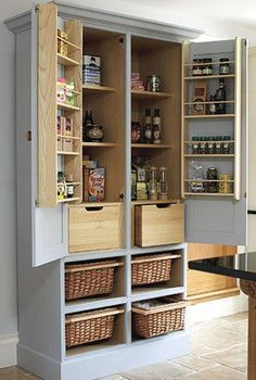 Free standing kitchen pantry cabinet with 4 sliding wicker baskets, 2 solid oak drawers and herb racks. Recycled TV armoire?