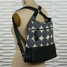 This handmade handbag converts from a shoulder bag to backpack. Durable construction and timeless style that will last a lifetime by mims maine.