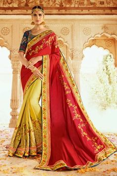 Lemon yellow and scarlet red saree with blouse. Work - Heavy zari, resham embroidery with stone work and lace border. Paired with the matching blouse piece. Blue Silk Saree, Red Saree, Art Silk Sarees, Chiffon Saree, Cotton Saree, Georgette Sarees, Pink Silk, Designer Sarees Wedding, Saree Wedding
