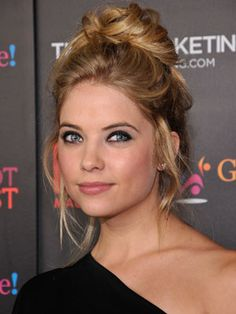 Ashley Benson's topknot. high, loose and perfectly messy!