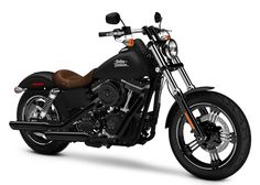 Custom Harley Street Bob. Matte black paint, brown leather accents, flat drag bars and oozing badassery.