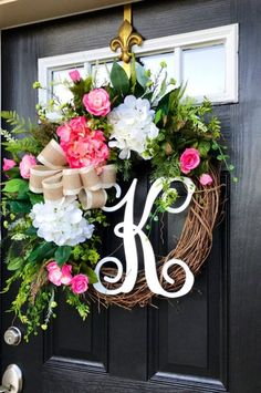 New! Gorgeous Spring Door Wreath!  Perfect for greeting guests to your home with this one of a kind door wreath.  Made up on an 18 grapevine wreath with moss, mixed flowing greenery of ferns, ivies,hydrangea leaves and ficus. Beautiful white and pink hydrangeas with pink roses and white accents. A decorative cream satin burlap bow and 12 white script monogram make this wreath so pretty and rustic. Such a pretty wreath for spring! Measures approx: 32x 25x 7( tip to tip). #afflink