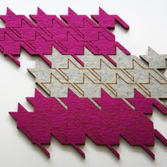 $40.00      pink    blue    green    grey     Add to Cart       Share  ×                            Permalink                                The pattern of the houndstooth on these wool felt table tiles allows the individual pieces to interlock so you can make a trivet for your tea pot, a placemat, or a colorful table runner.