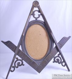 brass Masonic vintage picture frame, late 1800's, with compass & ruler design, $350, on Etsy.