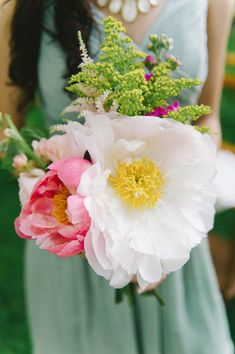 bouquet with oversized peonies, photo by Michelle Gardella http://ruffledblog.com/glittery-webb-barn-wedding #weddingbouquet #peony