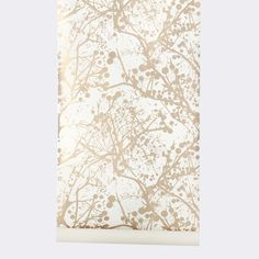 Wilderness wallpaper from Ferm Living. The pattern is great--a stylized version of the view when you look up at the sky in a forest. Not sure about the gold color, though.