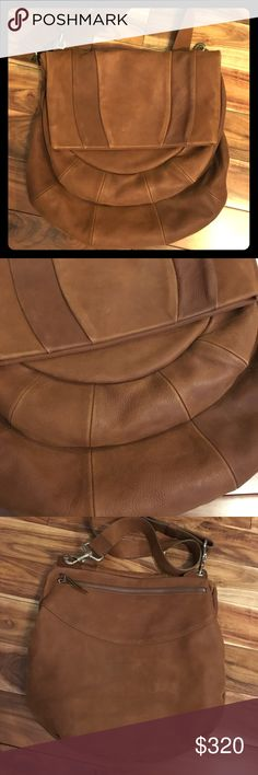RARE Claudio Orciani Leather Crossbody Hobo EUC GORGEOUS Orciani Italian designer bag. Large messenger cross body/hobo style. 14x14 in with adjustable, thick strap for comfort. Beautiful stitching detail and shape, british tan/cognac color. Flap opens to reveal small pocket and larger pocket. Open the top edge of the flap to get to the inside or use the back zipper for easier access. Zipper pocket and 2 slide pockets inside. Some wear on hardware, inside like new! Amazing quality and…