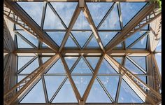 Don't miss these special latticed joists! By Foster & partners, photo Nigel Young. #architecture in #wood