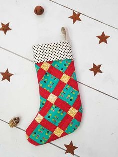 It's time to get into the holiday spirit because Christmas is just around the corner! This year I wanted to share with all of you a fun, patchwork-filled Christmas stocking using my Nuncia collection. Perfect for filling with gifts, candy canes, and treats! This stocking is perfect to put next to their Christmas tree. So lets get to sewing! #christmas #stocking #patchwork #free #project #tutorial