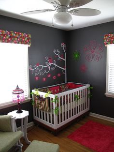 Paint one wall with chalkboard paint and then not only can they draw once old enough, but you can change up the design or write love notes to them... <3