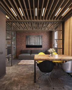 The design choices throughout are bold and here, unlike the previous showcased space, exposed brick is just one of many visual design choices that seem to work together perfectly.