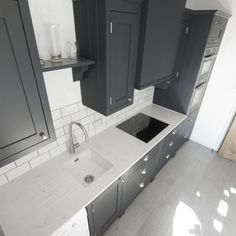 A classic timeless space that consists of sleek, sultry grey cabinetry mixed with the Carrera style quartz as worktops. A creative use of colours to complement eachother and produce a modern hub of the home. Carrara Quartz, Quartz Rock, Shaker Style Kitchens, Marble Effect, White Quartz, Luxury Kitchens, House Projects, Kitchen Styling, Carrera