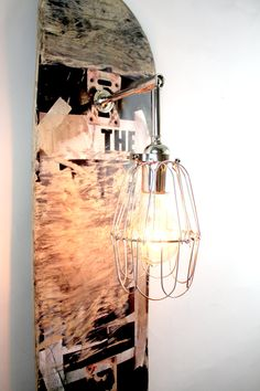 Repurposed Skateboard Lamp // Wood Sconce // Black Industrial Lighting // Chrome Cage Light // Original Skate Sconce by MFEO. $135.00, via Etsy.