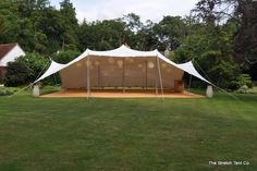 A much smaller tent - but the picture shows Chinese lanterns and the corn matting.