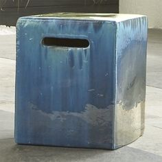Cascades of deep blue glaze flow in artisanal washes over cube-shaped stool, ready to pull up for garden tasks and extra patio seating. Also sets a beautiful stage for potted plants or chair-side drinks. Cut-out handles transport with ease.
