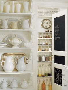white ceramics and organized pantry with chalkboard door / steve gross & sue daley