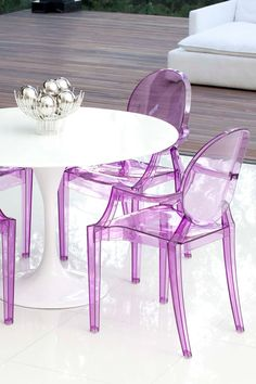 Love these clear purple dining chairs // based on a Philipe Starck design