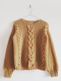mix of textures for brown sweater