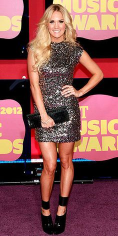 Carrie Underwood looks glam (and sparkly!) at the CMT Music Awards!   http://www.people.com/people/package/gallery/0,,20599448_20601887,00.html