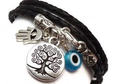 LEATHER WRAP BRACELET WITH PROTECTIVE CHARMS  This protective charms wrap bracelet features three protective charms - a tree of life, a hamsa, and a Turkish glass evil eye.