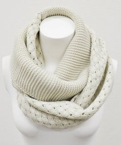 Get the layered look this fall with a single circle of knit goodness. The infinity scarf can be looped once, twice, or multiple times for a cozy and chic look.15'' x 28''100% acrylicHand washImported