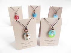 Assorted kiln-fired glass charms with copper rings. These delivered to Arts On Queen Beaches Toronto #shoplocal #glassandmetal @artsonqueen