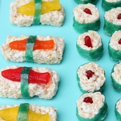 Dessert sushi -- perfect for an under the sea party!  Just Rice Krispy treats with Swedish fish and fruit roll-ups for the seaweed.