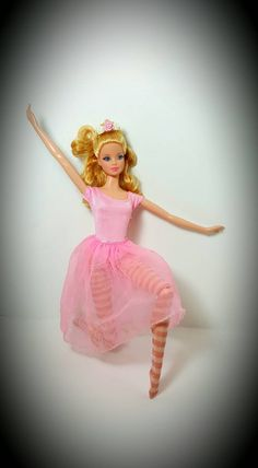 Check out this item in my Etsy shop https://www.etsy.com/listing/268648288/barbie-doll-size-12-inch-doll-pink-and