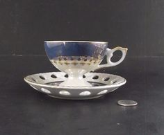ANTIQUE FOOTED JAPAN CABINET TEA CUP AND SAUCER