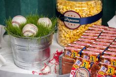 Baseball themed party with decorative table top centerpieces, popcorn and good ole Cracker Jack! sports party food