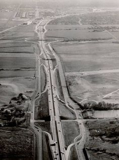 This is a shot of the Central Expressway in Dallas, 1959. You're looking south toward downtown. The overpass at the bottom of the photo is Walnut Hill Lane. Park Lane is the next overpass and then the cloverleaf overpass is Northwest Highway. I'd say this area has changed just a LITTLE bit since this was taken. It's hard to believe that it ever looked like this.